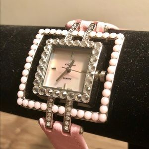 Pink leather band and swarovski crystal watch